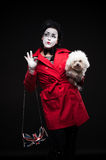 Woman mime with puppy Stock Photography
