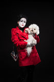 Woman mime with puppy Royalty Free Stock Photos