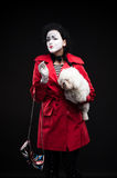 Woman mime with puppy Stock Image