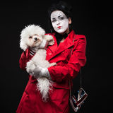Woman mime with puppy Stock Photos