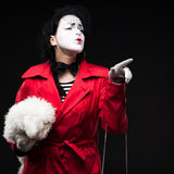 Woman mime with puppy Stock Images