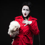 Woman mime with puppy Stock Photo