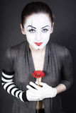 Woman  mime with  red flower Stock Photo