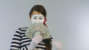 Woman mime shows fan of dollars. Concept: you can win many dollars. Woman mime shows fan of dollars. HD video stock video footage