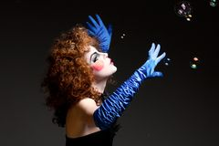 Woman mime with soap bubbles. Royalty Free Stock Images