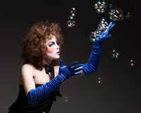Woman mime with soap bubbles. Royalty Free Stock Photography