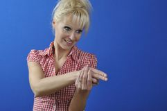 Woman miming gesture of holding a gun Stock Photography