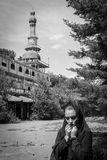Woman at the minaret. Woman and the minaret & x28;Black and White Photo& x29 Royalty Free Stock Image
