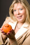 woman mineola orage tangerine  fruit for h Stock Photo