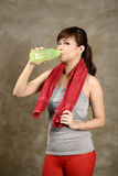 Woman mineral water after exercise Stock Images
