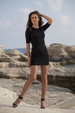 Woman in mini dress on the beach Stock Photo