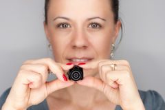 Woman with mini photocamera Stock Images