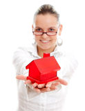 Woman with miniature house Stock Photos