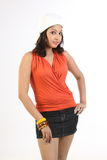 Woman with miniskirt and cap. Woman standing with miniskirt and cap Royalty Free Stock Images