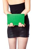 Woman in miniskirt is holding the book Royalty Free Stock Photography