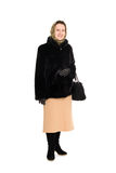 Woman in a mink coat Stock Images