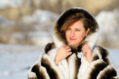 The woman in a mink fur coat Stock Photography