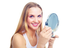Woman with a mirror Royalty Free Stock Images