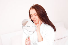 Woman with a mirror Royalty Free Stock Photos