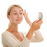 Woman with mirror. Portrait of young beauty woman with mirror stock photography
