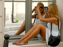 Woman in the mirror. Young teen girl and her mirror image reflection in window Stock Photography