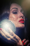 Woman with mirror ball Royalty Free Stock Photography