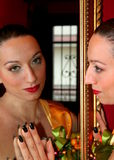 Woman and mirror. Beautiful woman in the mirror Stock Photo