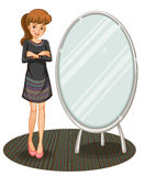 A woman beside a mirror Stock Images