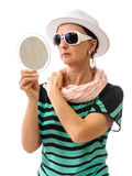 Woman with mirror isolated on white Stock Photography