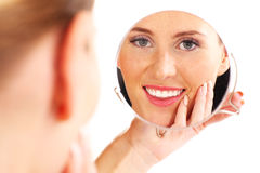 Woman and mirror Stock Photos