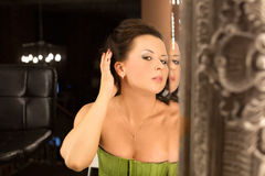 Woman and mirror Royalty Free Stock Photos