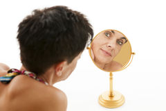 Woman in the mirror on white Royalty Free Stock Photos
