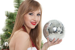 Woman with mirrored ball  near christmas tree. Royalty Free Stock Photos