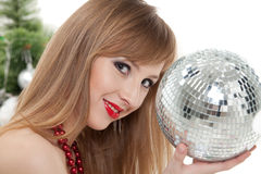 Woman with mirrored ball  near christmas tree. Stock Photos