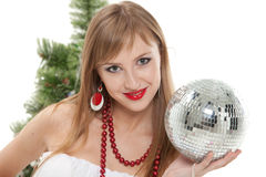 Woman with mirrored ball  near christmas tree. Stock Photography