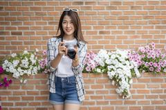 Woman with mirrorless camera royalty free stock photos