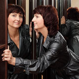 Woman and mirrors Royalty Free Stock Image