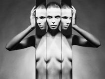 Woman and mirrors. Fashion studio portrait of nude elegant woman and mirrors on black background Royalty Free Stock Image