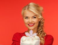 Woman in mittens and red dress with snowflake Stock Photography