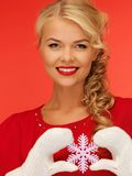 Woman in mittens and red dress with snowflake Royalty Free Stock Photo