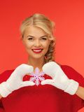 Woman in mittens and red dress with snowflake Royalty Free Stock Photography