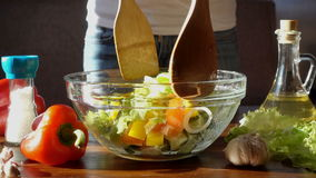 Woman mixed healthy salad on kitchen, slow motion hd video stock video footage