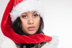 Woman mixed race santa helper hat portrait Stock Photography