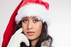 Woman mixed race santa helper hat portrait Stock Images