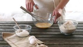 Woman mixes ingredients for sponge cake stock video footage