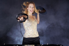 Woman on the mixing console with headphones Royalty Free Stock Photo