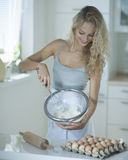 Woman mixing cookie batter in kitchen at counter Stock Image