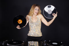 Woman on the mixing desk with vinyl records Stock Images