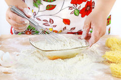 Woman mixing dough Royalty Free Stock Photography