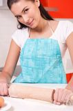 Woman mixing dough on the table Stock Image